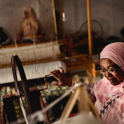 Morocco, Ain-Leuh. November 2011. Khaddouj Ouchekak is Forty-four years old, she started her first microcredit ten months ago. She prepares thread to sell to other people that makes traditional rugs.